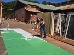 Hull Technician 2nd Class Tiffani Carlin painting soffit boards