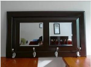 Cabinet door from ReStore, plus mirror tiles, hardware, and paint = hallway rack From: rockiescrafts.blogspot.com
