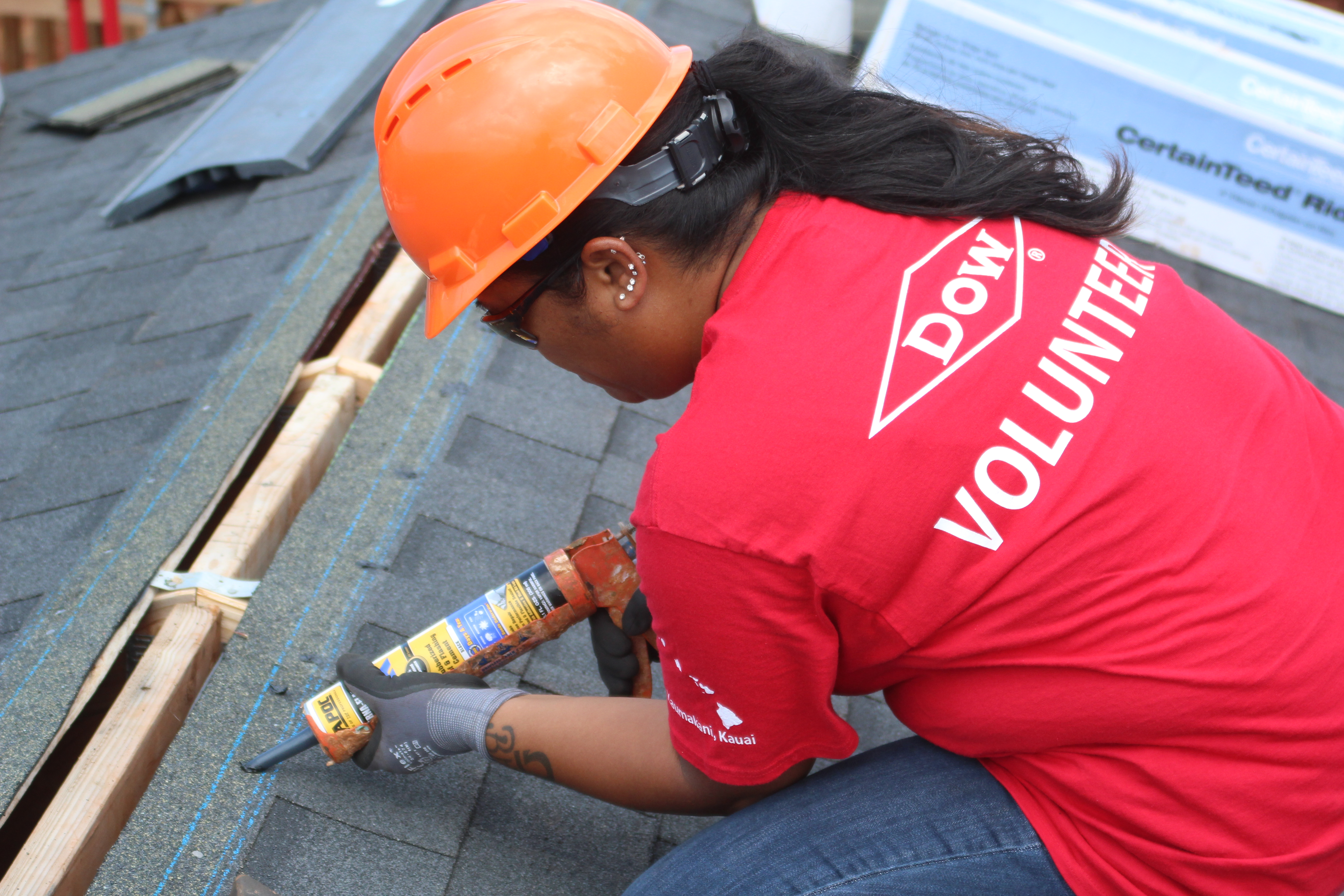 dow employee alicia vea applying roof sealant before installing